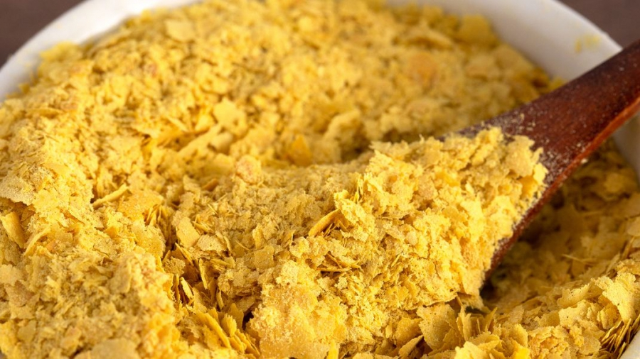 flakes-of-yellow-nutritional-yeast-a-cheese-royalty-free-image-1095512218-1556911617